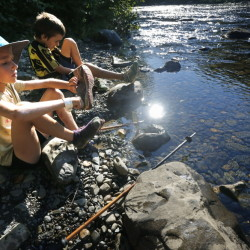 Madeline, 8, and Nathan, 9, Kallin put on their shoes after crossing a stream while hiking near Gulf Hagas, a registered national landmark along the Appalachian Trail corridor.  Derek Davis/Staff Photographer