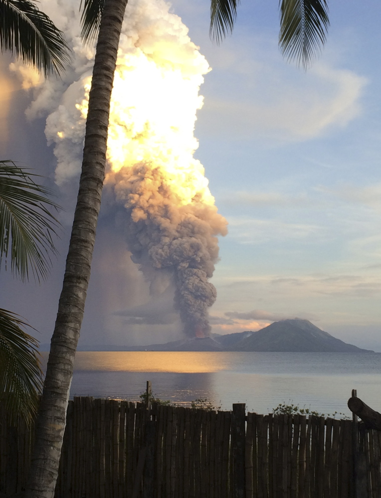 A huge smoke billows from Mt. Tavurvu after an eruption in Kokopo, east New Britain, Papua New Guinea.