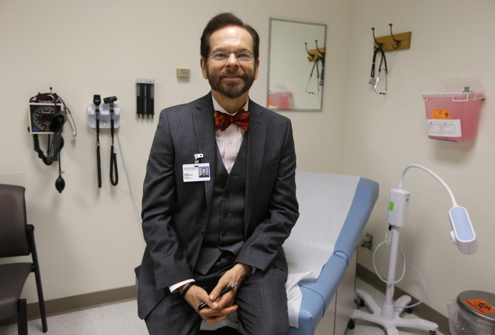 Dr. Robert Palinkas, director of the McKinley Health Center at the University of Illinois, stands in an exam room in Urbana, Ill. Extra health checks are part of protocols campuses throughout the United States have in place as they prepare for as many as 10,000 students from Nigeria, Guinea, Liberia and Sierra Leone, where more than 1,000 people have died in the worst Ebola outbreak in history.