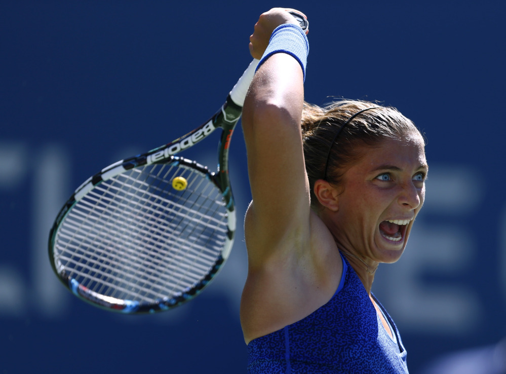 Sara Errani hits a shot against Venus Williams during their third-round match Friday. Errani, seeded 13th, advanced to face 121st-ranked qualifier Mirjana Lucic-Baroni.