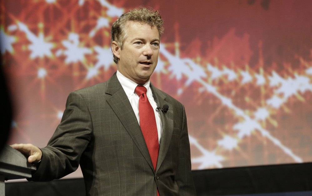 Kentucky Sen. Rand Paul speaks at the Americans for Prosperity gathering Friday, Aug. 29, 2014, in Dallas. Paul and Texas Gov. Rick Perry are bashing what they call the president's lack of leadership in response to the violent militant group attacking cities in Iraq. Both are among four top Republicans considering 2016 White House bids addressing the conservative summit in Dallas. (AP Photo/LM Otero)