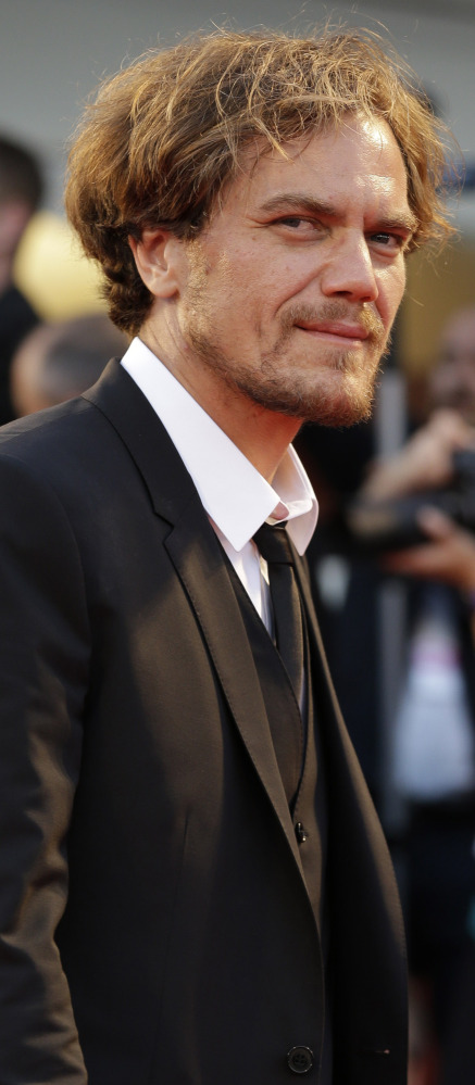 "Actors Michael Shannon, above, and Andrew Garfield, below, arrive for the premier of ""99 Homes"" at the 71st Venice Film Festival in Italy on Friday. The film's director, Ramin Bahrani, said he was ""dizzied by the corruption"" in Florida when he was researching his Orlando-set drama on the subprime crisis."