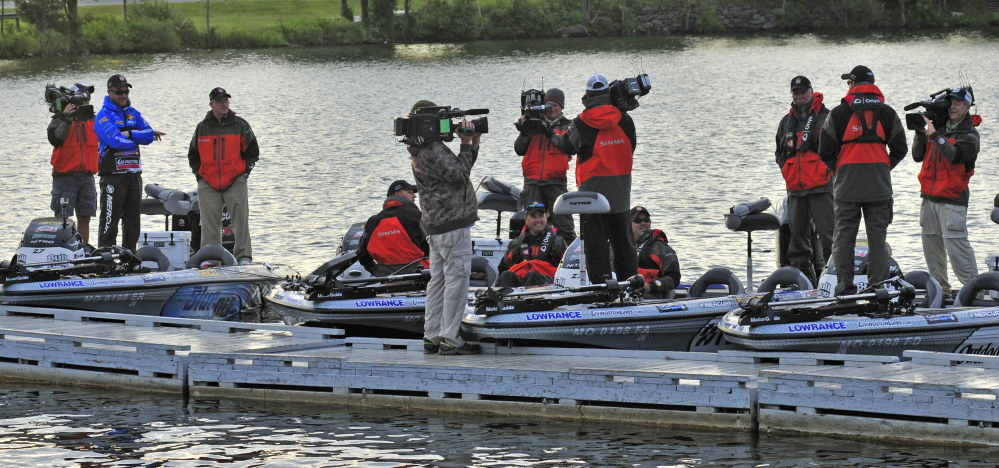 "Competitors, production crew members for the television program ""Major League Fishing"" and officials get ready for action early Saturday morning at China Lake in China. Thirty top anglers from around the nation came to Maine for an invitation-only bass fishing competition."