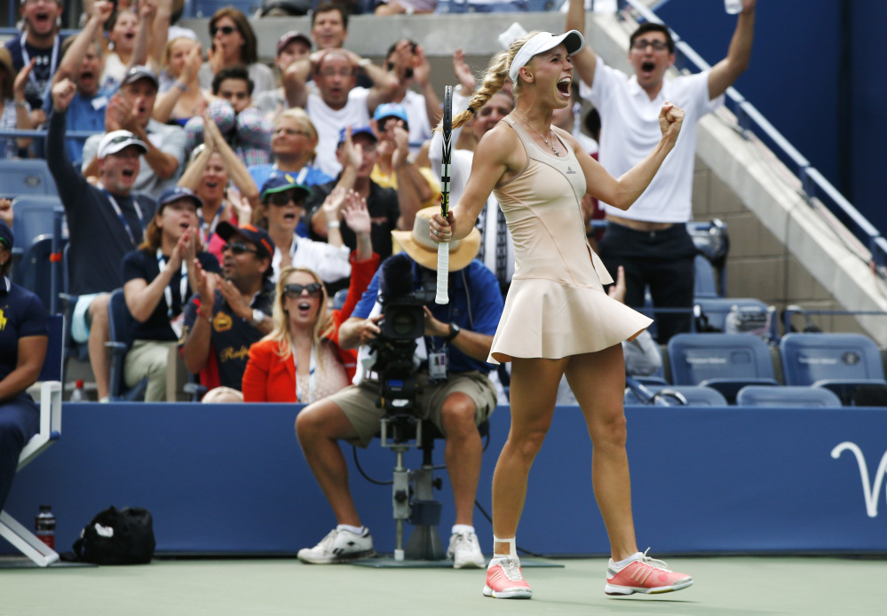 Caroline Wozniacki reacts after winning a point against Maria Sharapova Sunday at the U.S. Open in New York. Wozniacki, seeded 10th, knocked off fifth-seeded Sharapova in three sets to reach the quarterfinals.