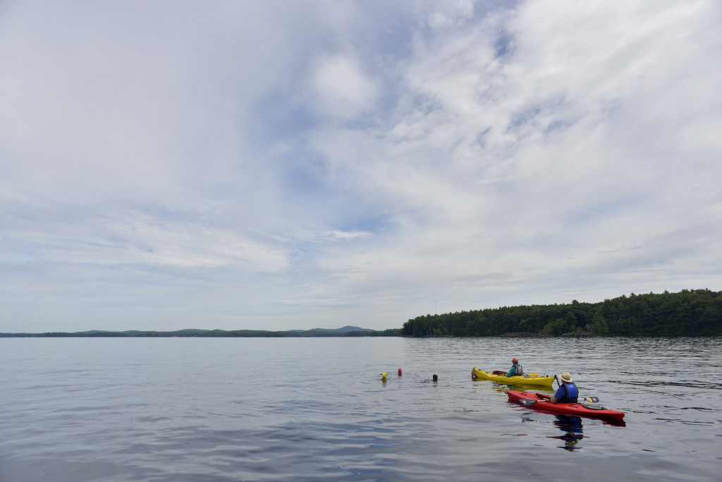Four active-duty Navy SEALs swim 13-mile length of Sebago Lake for a Camp Sunshine fundraiser on Thursday.