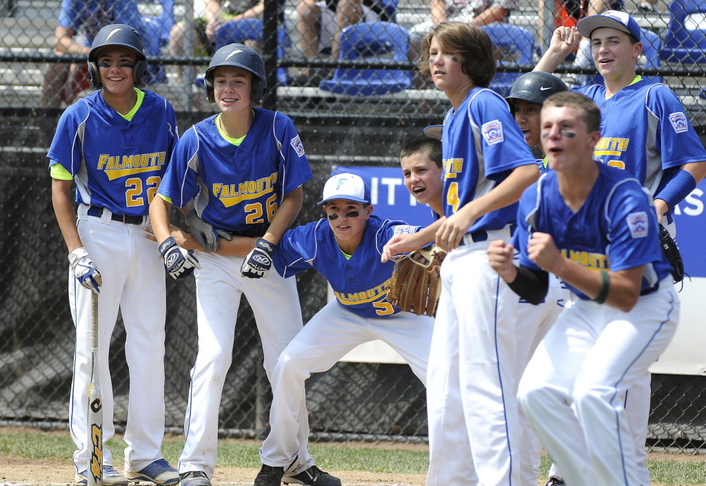Teammates wait for Falmouth's Michael Simonds to round the bases on his home run during Falmouth's win on Tuesday.