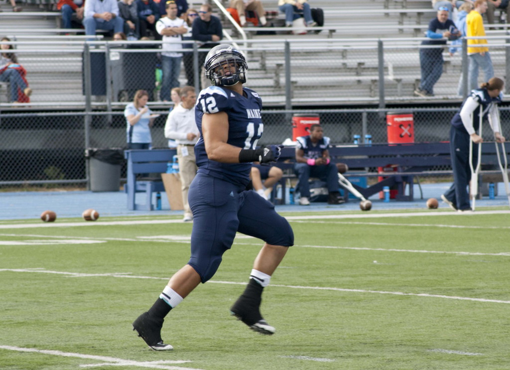 Although mainly used as the lead blocker for the tailback, fullback Carlton Charles of Maine can haul in a pass on a short route when needed. Photo courtesy of UMaine