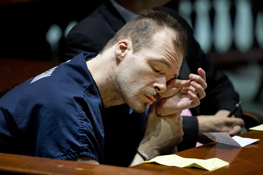 Brian Morin, 31, wipes his eyes in Androscoggin County Superior Court in Auburn on Wednesday before being sentenced to five years in prison followed by 12 years of probation on three counts of felony arson for fires that burned vacant buildings in downtown Lewiston in the spring of 2013.