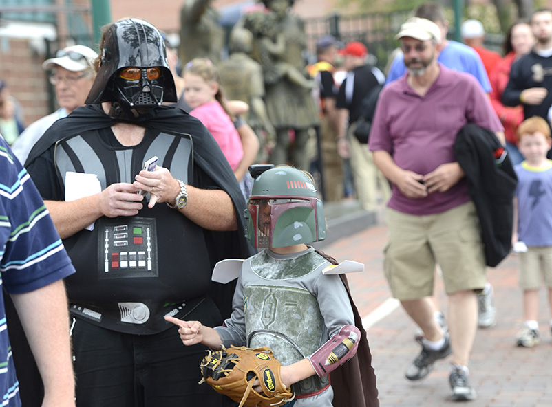 Joe LaDow and his son Jareth, 7 yrs. from Somersworth, N.H. wait in line to see the Portland Sea Dogs host the Richmond Flying Squirrels and celebrate Star Wars Night at Hadlock Field in Portland. John Patriquin/Staff Photographer
