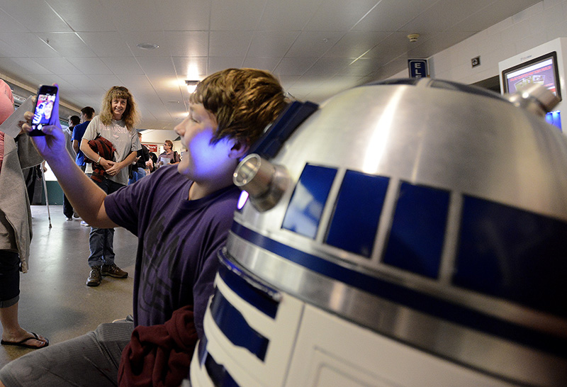 Cameron Jackson, 14, from Casco takes a selfie with R2D2 before the Portland Sea Dogs host the Richmond Flying Squirrels and celebrate Star Wars Night at Hadlock Field in Portland. John Patriquin/Staff Photographer