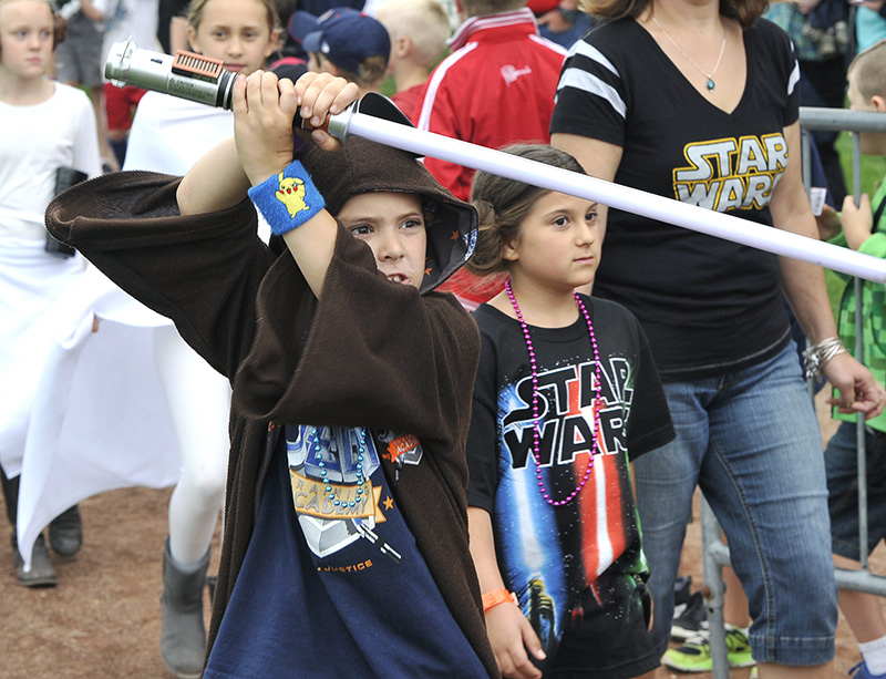 Paul Beaupre, 8, from Granby, Mass. and his cousin 7 yr. old Zoe Cole from Madison, N.H. walk in the parade before the Portland Sea Dogs host the Richmond Flying Squirrels and celebrate Star Wars Night at Hadlock Field in Portland.John Patriquin/Staff Photographer