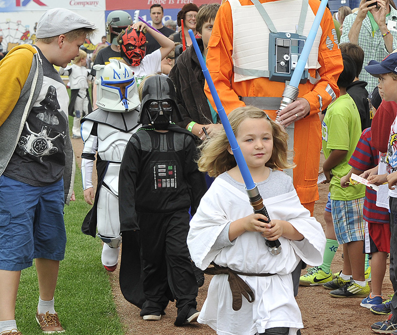 Clover Pross, 5, from Auburn leads the parade before the Portland Sea Dogs host the Richmond Flying Squirrels and celebrate Star Wars Night at Hadlock Field in Portland.  John Patriquin/Staff Photographer