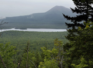 Barnard Mountain, located in the Katahdin Woods & Waters Recreation Area, offers an excellent view of Mount Katahdin and Katahdin Lake. This photo was taken in June 2014 and a trail crew from the Maine Conservation Corps has since opened up the view of Katahdin by taking down a few trees.