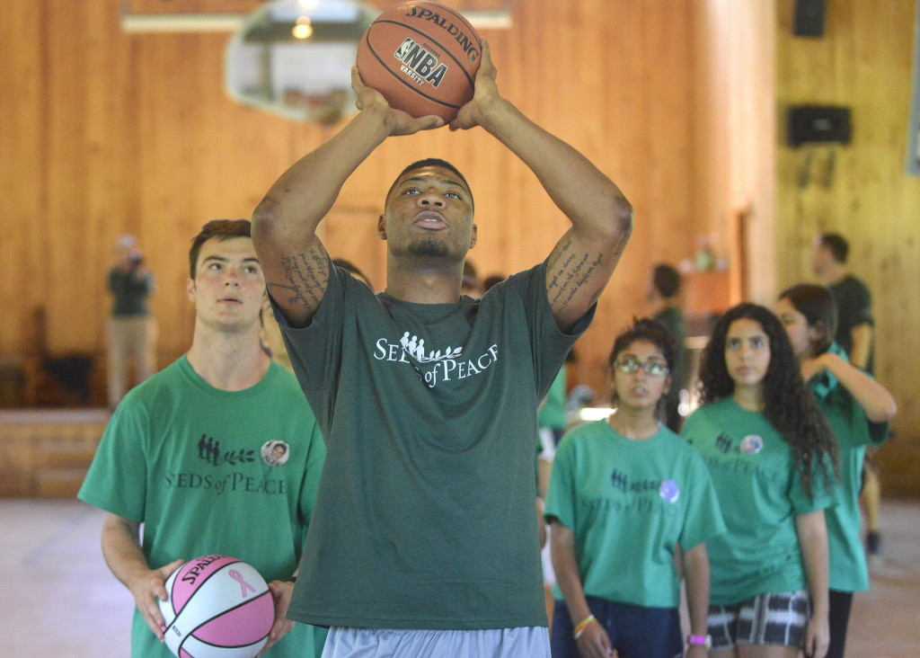 Marcus Smart demonstrates his shooting techniques to Seeds of Peace campers on Friday in Otisfield.