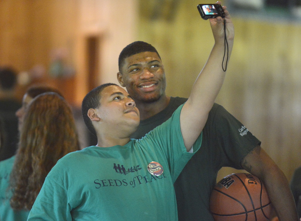 Boston Celtics rookie point guard Marcus Smart poses for a selfie with Omar Abdel, a Seeds of Peace camper from Egypt.
