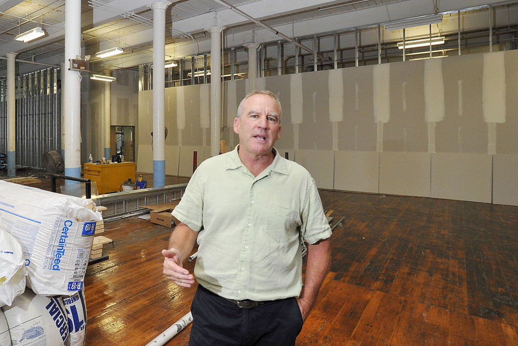 Doug Sanford, the developer of Pepperell Center, takes a completely open floor of an old mill and creates hallways and rooms to fit the needs of his clients.