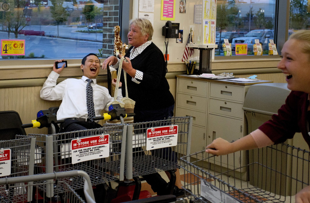 Edward Foye, a grocery clerk at the Market Basket in Biddeford, laughs as Joanne Twomey, former mayor of Biddeford, runs into the store around 7:15 p.m. Friday to celebrate the indications that Arthur T. Demoulas was going to buy the company. At right is employee Jackie Murphy. Nothing will be made official until the board meets to discuss the bids. Gabe Souza/Staff Photographer