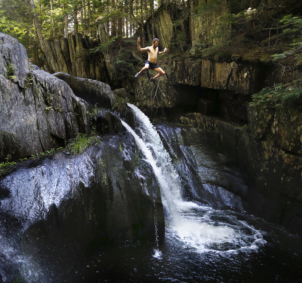 Dave Kallin leaps into a waterfall while hiking with his family at Gulf Hagas, a registered national landmark along the Appalachian Trail corridor. The Dresden family started out on the AT in Georgia in April.