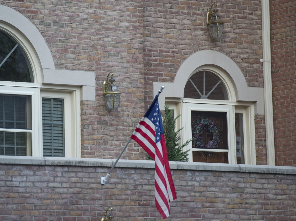 An American flag hangs above the front door of the home of Maj. Gen. Harold Greene in Falls Church, Va., Tuesday. The Associated Press