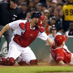 Angels outfielder Mike Trout slides safely home to score on Josh Hamilton's sacrifice fly as Red Sox catcher David Ross is late with the tag in the fifth inning oat Fenway Park on Wednesday. The Associated Press