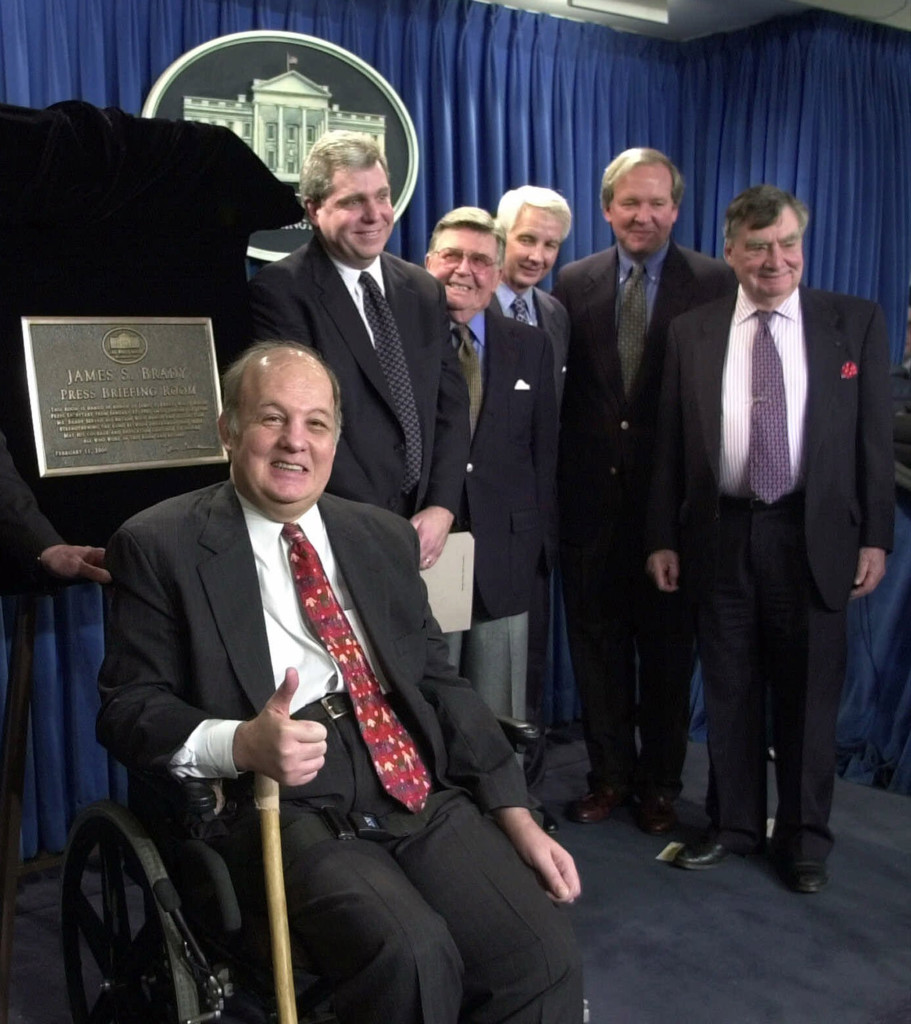 In this Feb. 11, 2000, photo, James Brady, former White House press secretary for Ronald Reagan, appears for the dedication of the new James S. Brady Press Briefing Room at the White House. From left are: Brady, presidential press secretaries Joe Lockhart (Clinton), Jerald terHorst (Ford), Larry Speakes (Reagan), Mike McCurry (Clinton) and Pierre Salinger (Kennedy). The Associated Press