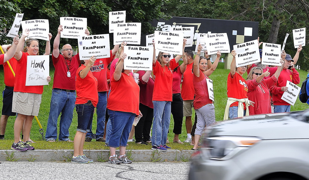FairPoint employees, members of IBEW and CWA unions, react to honking horns of support as they picket at  the corner of Riverside and Davis Farm Road in Portland Tuesday. Gordon Chibroski / Staff Photographer