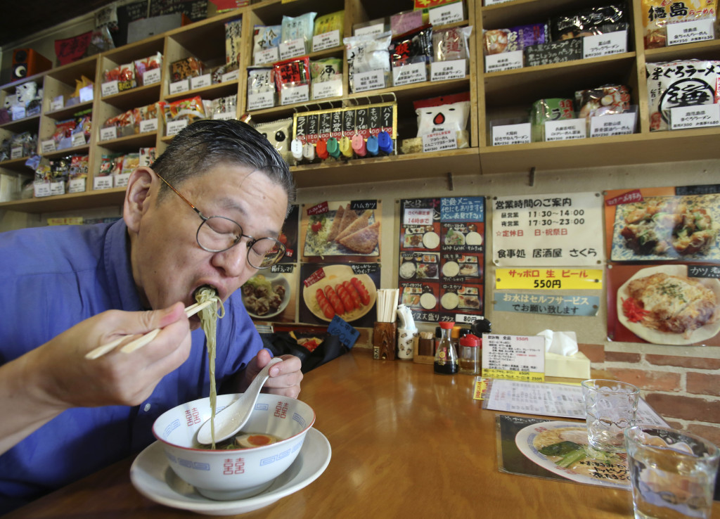 """Japanese instant ramen noodle expert Masaya """"Sokusekisai"""" Oyama, 55, slurps instant ramen noodle at a shop & restaurant specialized only in varieties of instant noodles in Tokyo. Oyama knows a lot about the instant noodle. He eats more than 400 instant noodles a year, and he usually goes by his nickname """"Sokusekisai,"""" which means """"instant."""" He agrees eating only instant noodles is not good for your health, because eating one thing all the time isn't healthy, no matter what it is."""