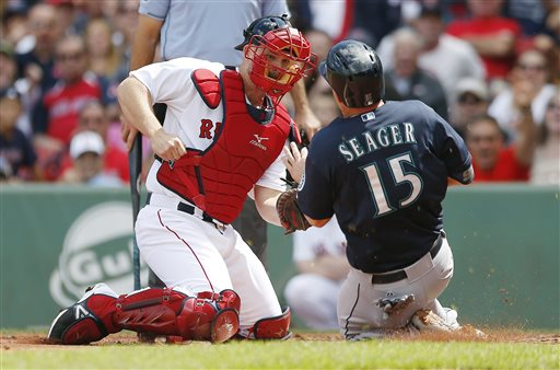 Red Sox's David Ross tags out Mariners' Kyle Seager in the second inning at Fenway Park in Boston on Saturday. The Associated Press