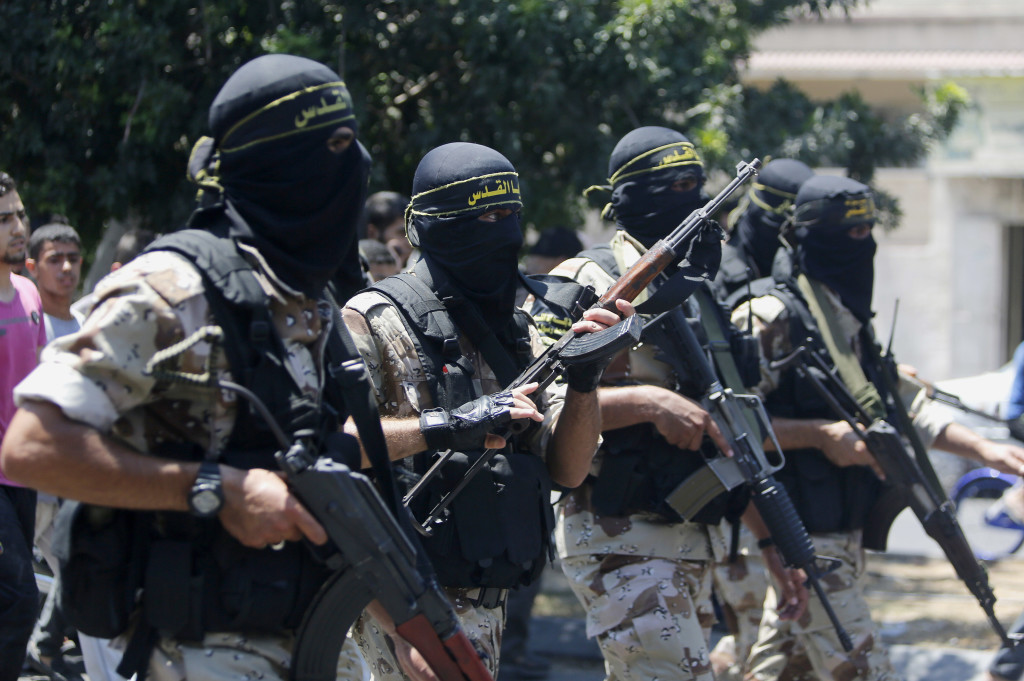 Masked militants of the Islamic Jihad group march during the funeral Wednesday of their comrade Shaaban Al-Dahdouh, whose body was found under the rubble Tuesday in Gaza City.