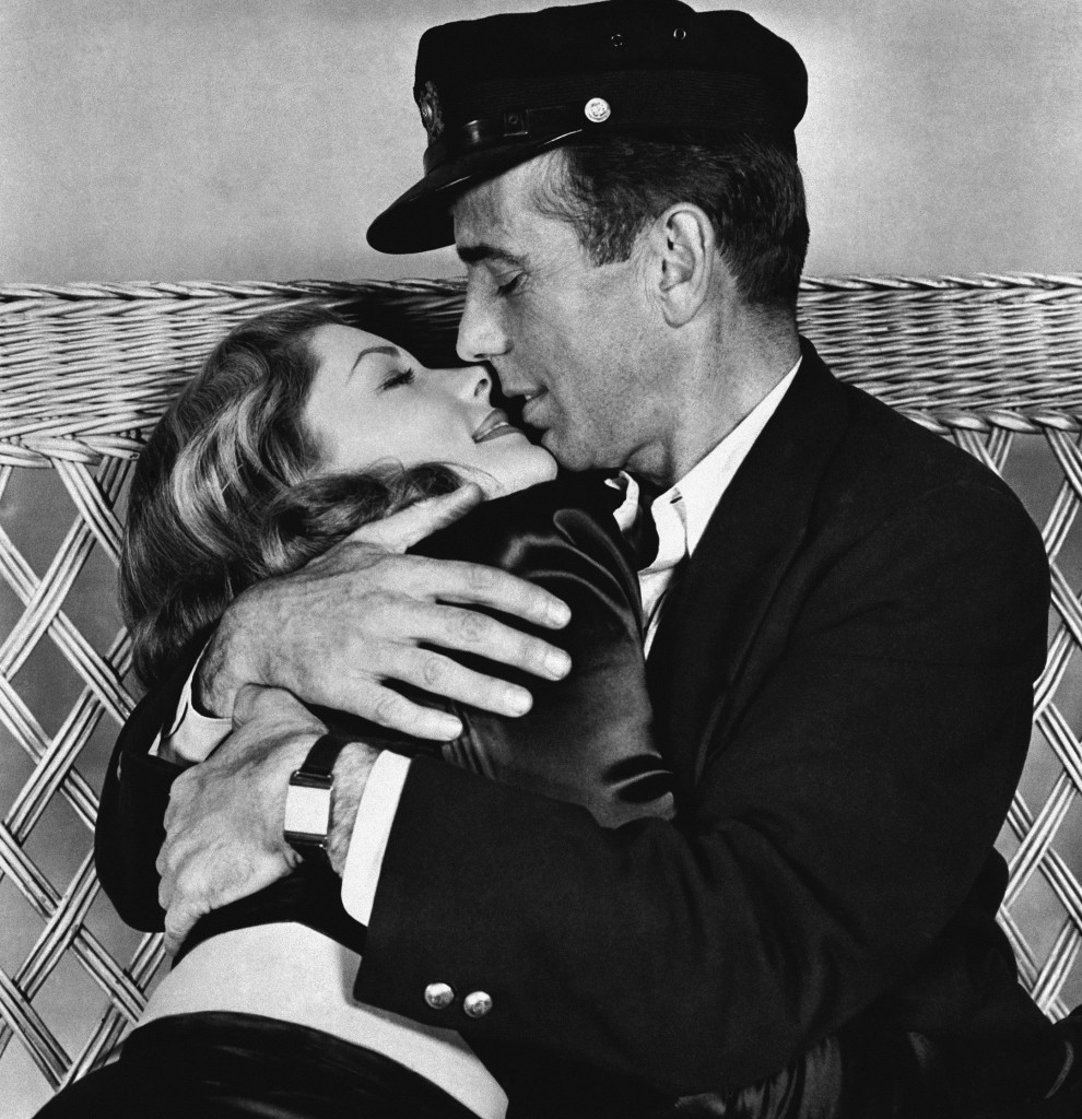 "This 1944 photo, originally released by Warner Bros., shows Humphrey Bogart holding Lauren Bacall in a scene from ""To Have and Have Not."" Bacall died Tuesday at the age of 89."
