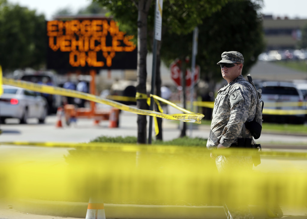 A member of the Missouri National Guard stands guard at a police command post Tuesday in Ferguson, Mo. Ferguson's leaders urged residents Tuesday to stay home after dark to