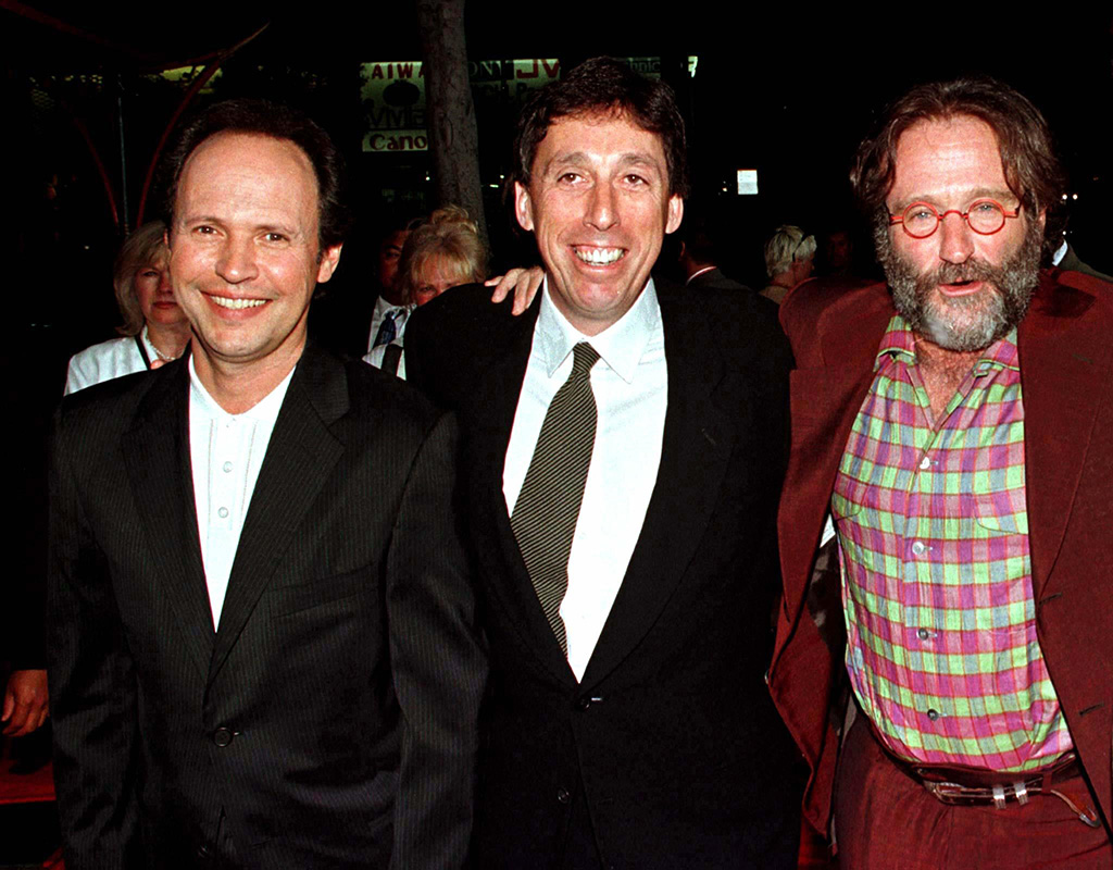 "Hollywood director Ivan Reitman, center, poses with Robin Williams and Billy Crystal as they arrive for the premiere of their new film ""Father's Day"" in this 1997 file photo."