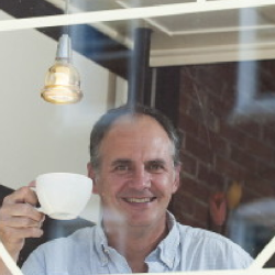 """Murray Campbell, author of """"Caffeinated,"""" has the usual, """"just coffee,"""" at Bay Wrap coffee shop in Belfast."""