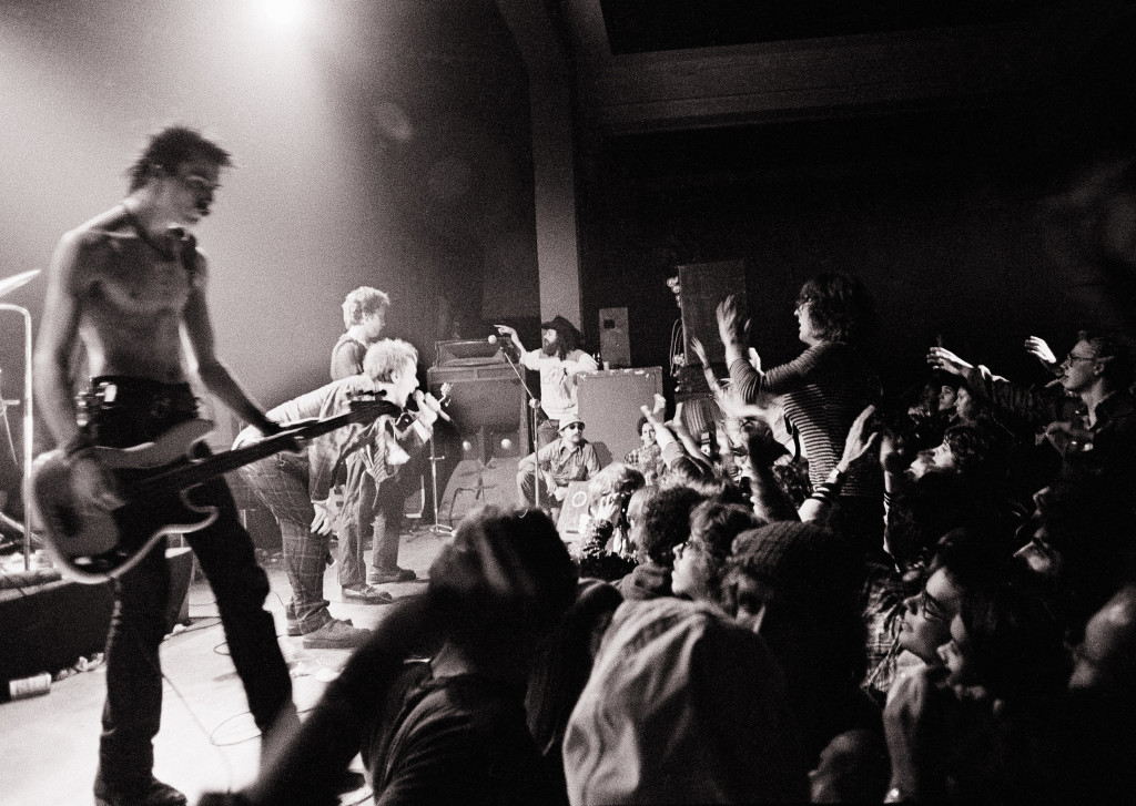 The Sex Pistols get a form of audience participation in Memphis, Tenn., in this Jan. 7, 1978, photo.  At left is bass player Sid Vicious. Group leader Johnny Rotten crouches next to him. The Associated Press