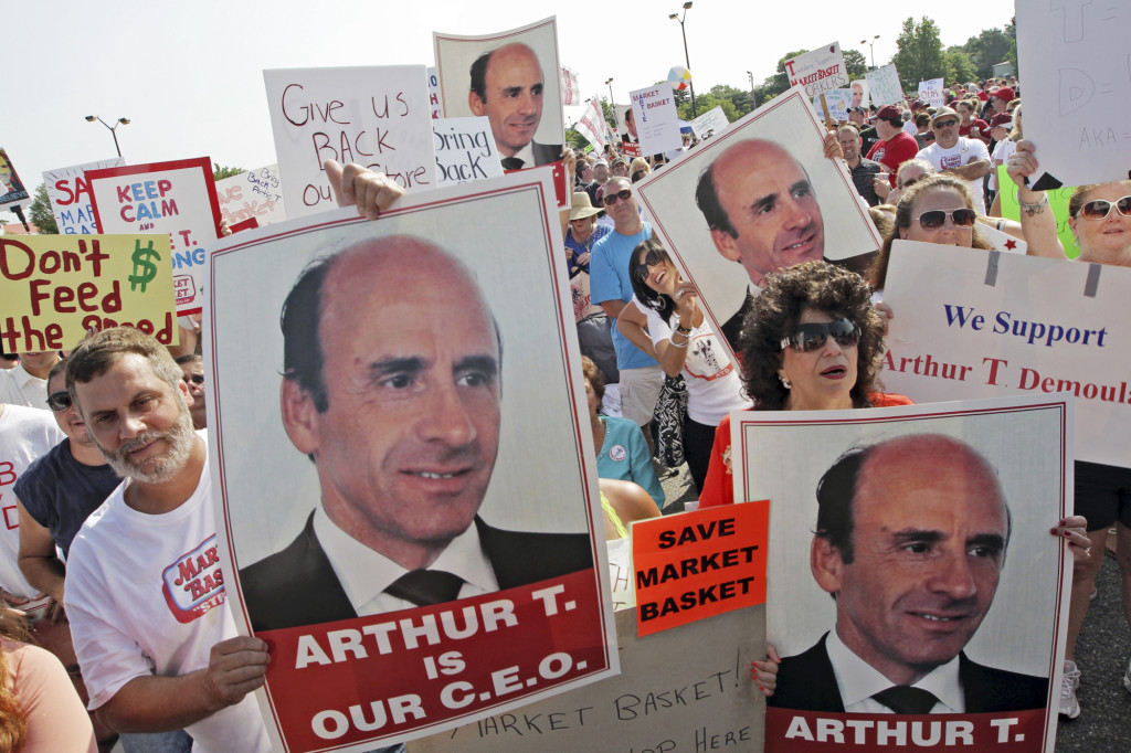 Market Basket supermarket employees and supporters hold a rally July 25, 2014, in Tewksbury, Mass., to back ousted former CEO Arthur T. Demoulas. The Associated Press