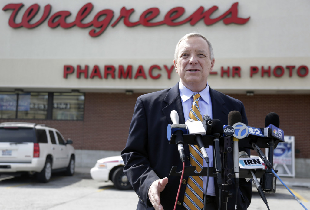 U.S. Sen. Dick Durbin, D-Ill., speaks during a news conference outside a Walgreen drugstore Wednesday in Chicago. Durbin praised Walgreen, the nation's largest drugstore chain, for declining to pursue an overseas reorganization to trim its U.S. taxes. The Associated Press