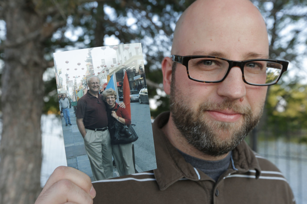 Jeremy Writebol holds a photograph of his mother and father in Wichita, Kan. His mother, Nancy Writebol, is a missionary who has been stricken with Ebola.