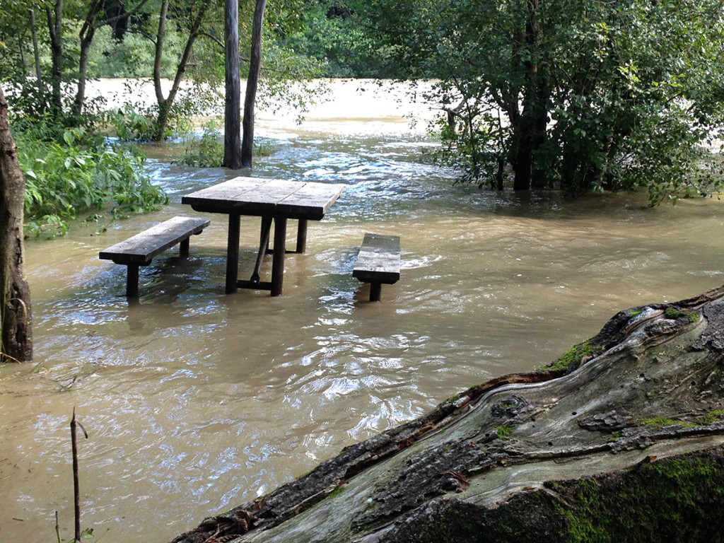 A picnic bench sits in the swollen river at Royal River Park in Yarmouth Thursday.