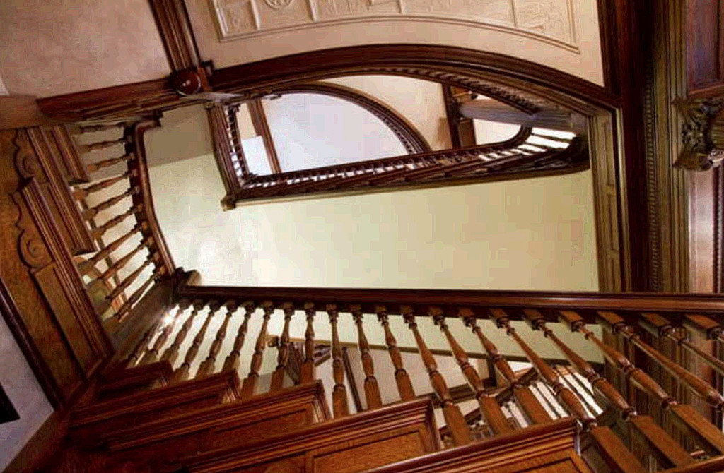 The centerpiece of the West Mansion is a dramatic three-story winding staircase crafted from tiger maple. Carl D. Walsh / Staff Photographer