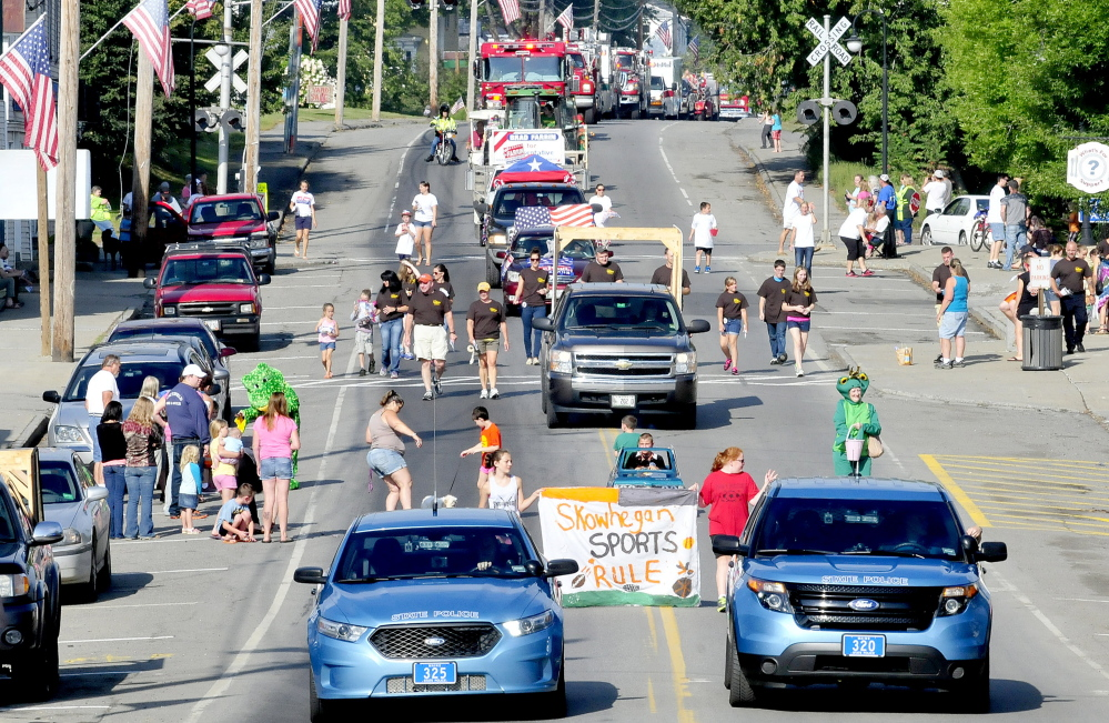 Police, firefighters, mutant turtles and public office candidates made up the Labor Day parade down Main Street in Norridgewock on Monday. Kennebec Journal Staff Photo by David Leaming