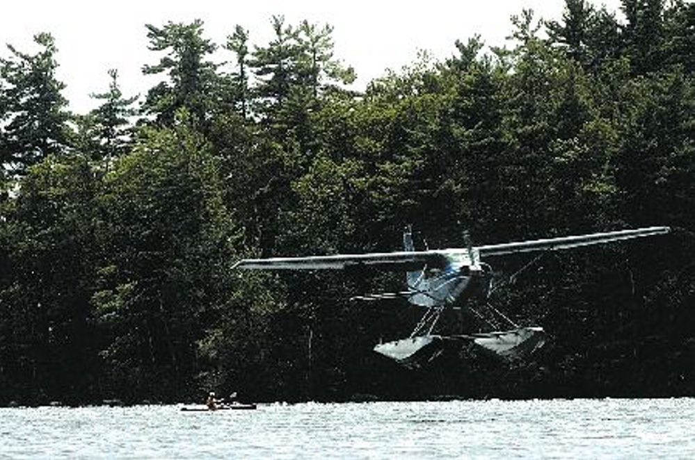 A float plane piloted by Bill McKay makes a landing approach on Messalonskee Lake in Oakland in this August 2006 photo. Morning Sentinel file photo