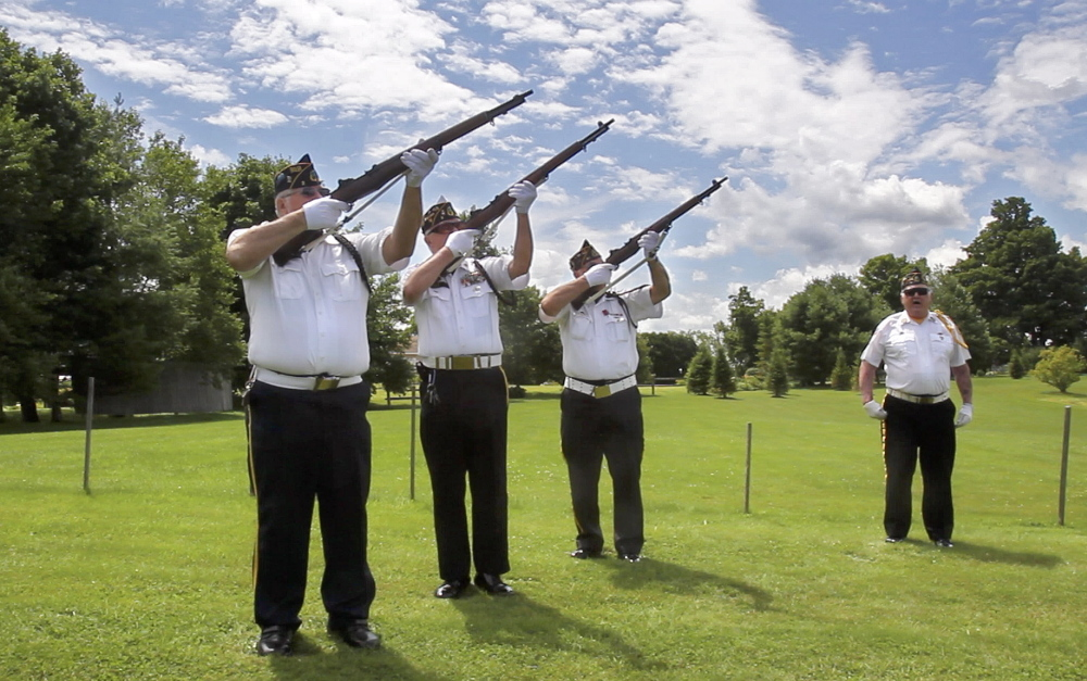 Jim Palmer, Patrick Eisenhart and Normand Bernier perform a rifle salute during a funeral at the Maine Veterans' Memorial Cemetery in Augusta. At right is Jim Keenan.