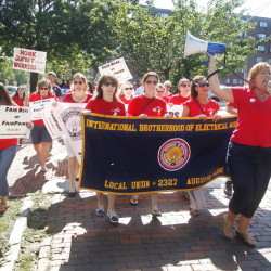 Jen Nappi of Portland, far right, leads fellow Fairpoint employees in a chant as they join the annual Portland Labor Day march from the Irish Heritage Center to Longfellow Square on Monday.