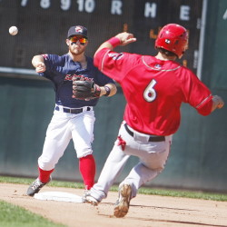 Sea Dogs' second baseman Sean Coyle throws to first as Harrisburg's Cole Leonida slides into second base Monday at Hadlock Field in Portland. Photographer)