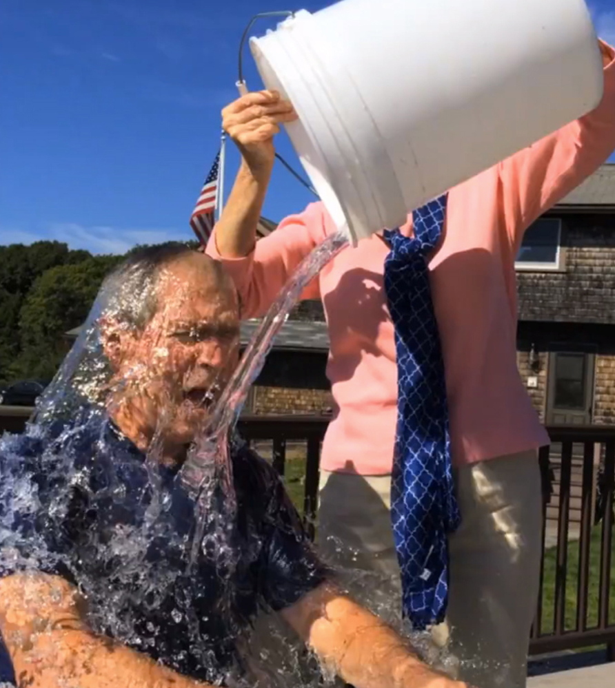 George W. Bush welcomes a good soaking in Kennebunkport, knowing that proceeds will go toward battling a crippling disease.