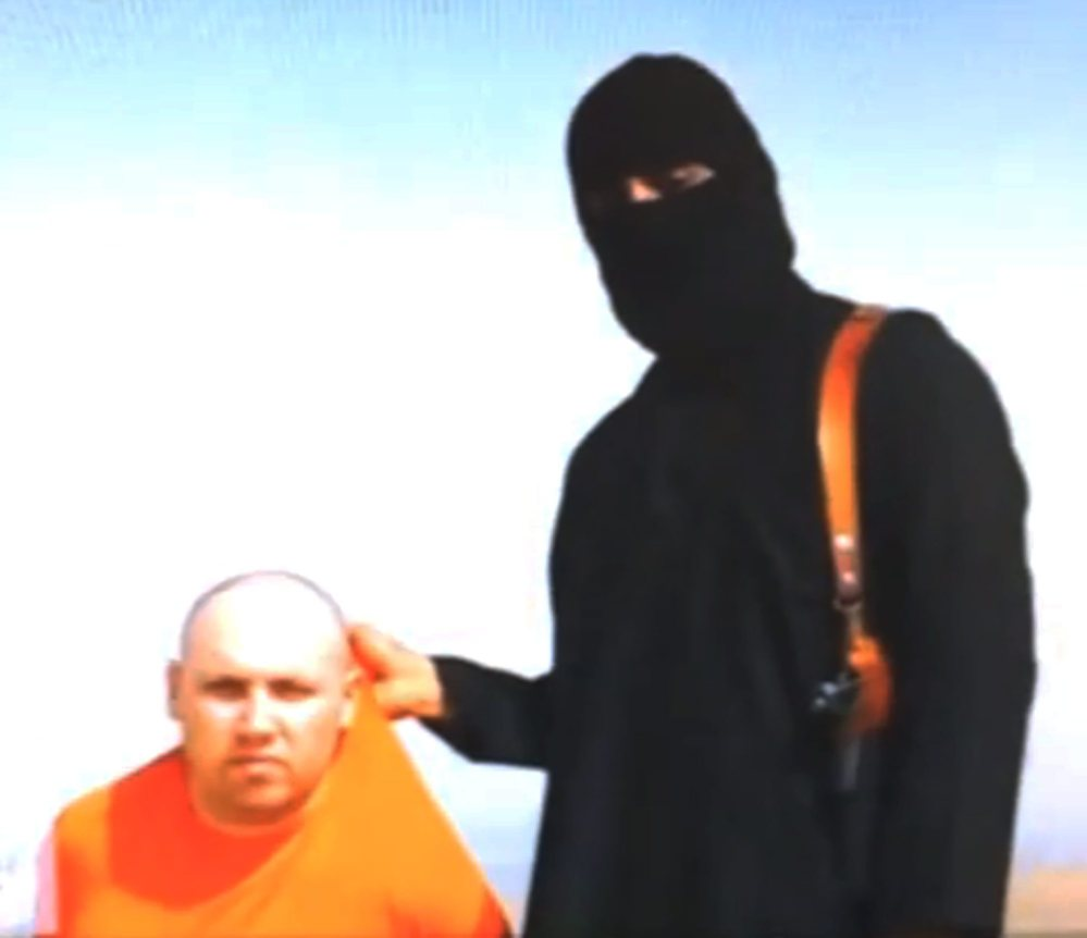 This still image from an undated video released by Islamic State militants on Aug. 19 purports to show journalist Steven Sotloff being held by the militant group.
