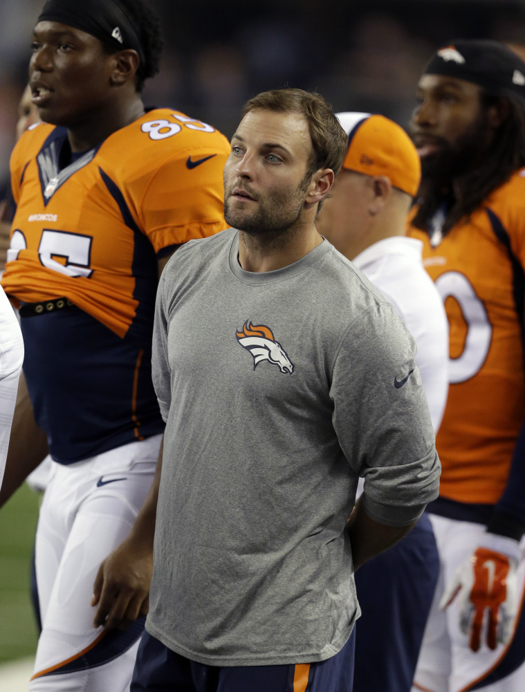 Denver Broncos wide receiver Wes Welker watches play from the sideline against the Dallas Cowboys on Aug. 28. According to multiple reports, Welker has been suspended for four games because of a positive test for amphetamines.