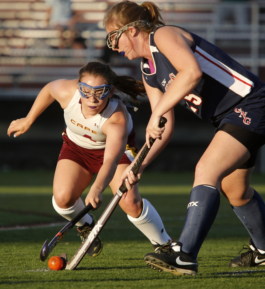 Makayla Pinette of Cape Elizabeth, left, tries to strip the ball from Skye Conley of visiting Gray-New Gloucester during the first half at Hannaford Field.