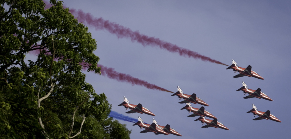 Military jets perform a fly-over during the NATO summit Wales on Friday.