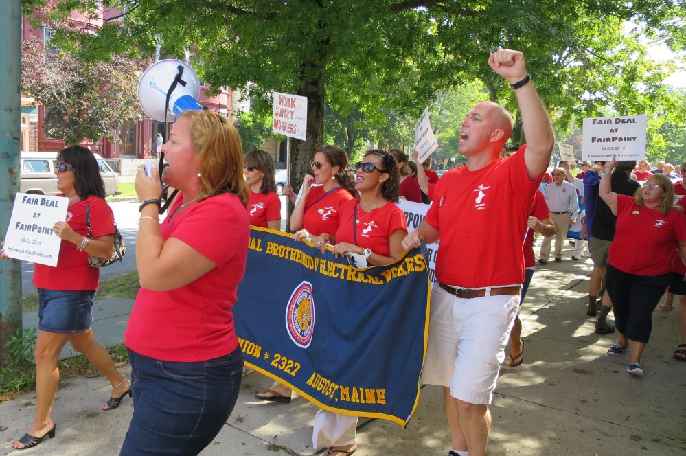 Members of the International Brotherhood of Electrical Workers march near Longfellow Square in Portland on Monday to call for FairPoint Communications to return to the negotiating table. The company, which provides telephone service in Maine, New Hampshire and Vermont, declared an impasse last week after four months of negotiations with two unions.
